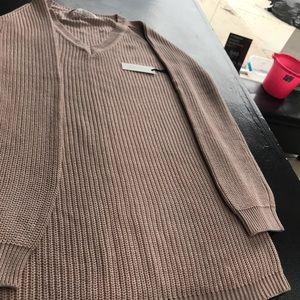 A pink knit sweater